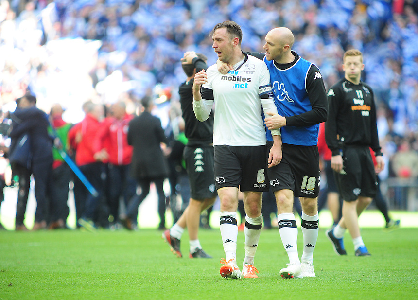 Derby County's Richard Keogh looks distraught as he is consoled by team-mate Conor Sammon at the end of the game<br /> <br /> Photographer Chris Vaughan/CameraSport<br /> <br /> Football - The Football League Sky Bet Championship Play-Off Final - Derby County v Queens Park Rangers - Saturday 24th May 2014 - Wembley Stadium - London<br /> <br /> &copy; CameraSport - 43 Linden Ave. Countesthorpe. Leicester. England. LE8 5PG - Tel: +44 (0) 116 277 4147 - admin@camerasport.com - www.camerasport.com