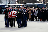 Former President George W. Bush, Laura Bush and other family members watch as the flag-draped casket of former President George H.W. Bush is carried by a joint services military honor guard to Special Air Mission 41, Wednesday, Dec. 5, 2018, at Andrews Air Force Base, Md. <br /> Credit: Alex Brandon / Pool via CNP