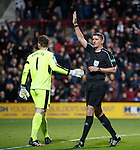 Ref Craig Thomson signals no goal as he consults with his assistant