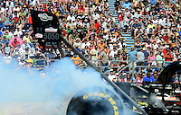Sept. 22, 2012; Ennis, TX, USA: NHRA fans in the grandstands look on as a top fuel dragster does a burnout during qualifying for the Fall Nationals at the Texas Motorplex. Mandatory Credit: Mark J. Rebilas-US PRESSWIRE