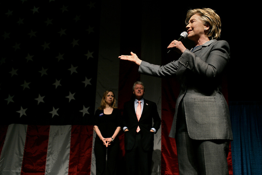 Senator Hillary Rodham Clinton, left, speaks during a fundraiser for her presidential campaign while her husband Bill Clinton and daughter Chelsea Clinton look on in New York, Monday, April 23, 2007.<br /> Photo by Brooks Kraft/Corbis