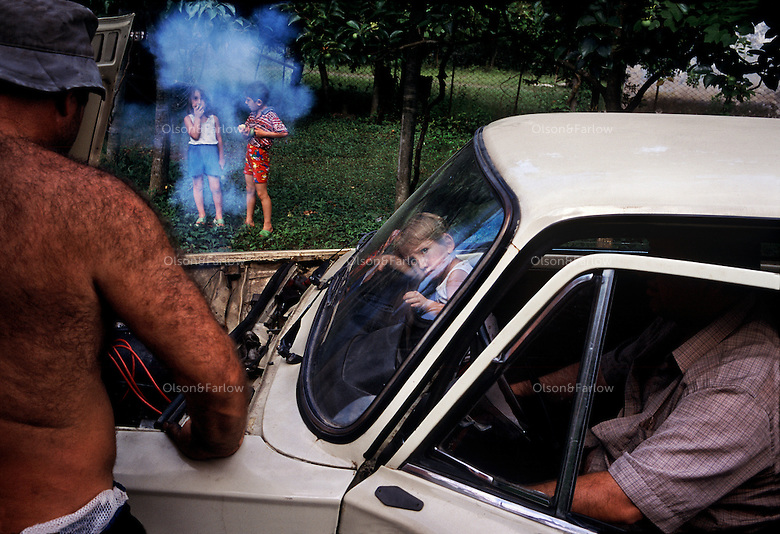 Zurab Liplisashvili, an unemployed Mingrelian geo-physicist and his family, can barely keep their 30-year old car running. This is a country where pensions are $7 a month and a normal salary is about $30 a month.  There is an alarmingly high suicide rate among folks who don't have a community to support them.  For example, if you don't have a farmer and a doctor in your family--and if you make $7 a month--you won't eat or have medical care.