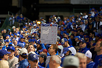 Chicago Cubs fans holding up signs in the third inning during Game 3 of the Major League Baseball World Series against the Cleveland Indians on October 28, 2016 at Wrigley Field in Chicago, Illinois.  (Mike Janes/Four Seam Images)