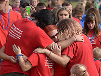 NWA Democrat-Gazette/BEN GOFF @NWABENGOFF<br /> Melisa Allred of Springdale and other members of Team Lexi Lives On embrace on Sunday Sept. 20, 2015 during the second annual Out of the Darkness Community Walk of Northwest Arkansas at Orchards Park in Bentonville. The fundraiser more than doubled in size this year, according to organizer Tyler West with the Arkansas Suicide Prevention Council, with 633 walkers raising $22,063 to help support suicide awareness and prevention efforts. Team Lexi Lives On walked in memory of Alexis Suzanne Riner, 15, who took her own life in June.