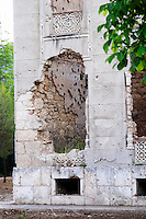 Building in Mostar damaged by the war and still not renovated. Ruined by bullet holes, mortar bomb shell grenade damage, very close to the beautifully renovated old town city centre. The Third Primary School building along Ante Starcevica street. Town of Mostar. Federation Bosne i Hercegovine. Bosnia Herzegovina, Europe.