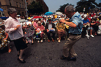 (950601-SWR05) BROOKLYN, NEW YORK -- File Photo -- A crowd watches as a couple of Senior Russian Emigrees dance at a Jewish Pride Street Festival in Brighton Beach..Photo  © Stacy Walsh Rosenstock