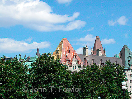 Copper roofs on Chateau Laurier Hotel, Ottawa, Canada showing at least five different degrees of corrosion