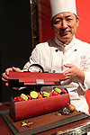"October 12, 2017, Tokyo, Japan - Japan's Prince Hotels executive chef pastry and bakery Takeshi Naito displays a handbag shaped Christmas cake ""Pour ma Chere"" priced 28,000 yen at a press preview for the hotel chain's Christmas cake collection at the Prince Park Tower hotel  in Tokyo on Thursday, Octoebr 12, 2017. The hotel chain started to accept orders and will deliver before Christmas Day.   (Photo by Yoshio Tsunoda/AFLO) LWX -ytd-"