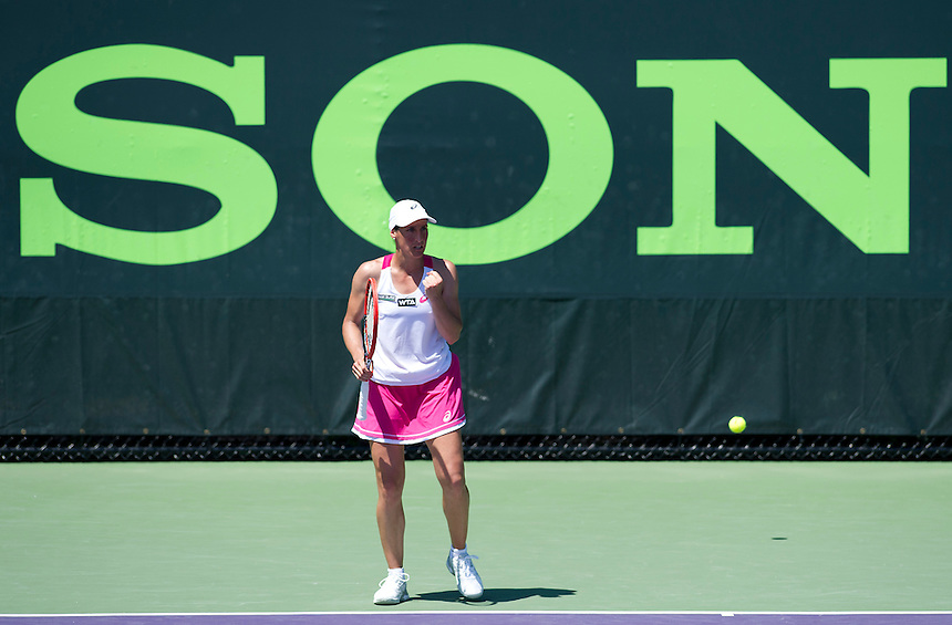 Virginie Razzano (FRA) celebrates her victory over Heather Watson (GBR) in their Women's Singles First Round match today - Virginie Razzano (FRA) def Heather Watson (GBR) 6-4 6-0<br /> <br /> Photographer Andrew Patron/CameraSport/BigShots<br /> <br /> Tennis - Sony Open Tennis - ATP World Tour Masters 1000 - Day 3 - Wednesday 19th March 2014 - Tennis Center at Crandon Park Key Biscayne, Miami, Florida USA<br /> <br /> &copy; CameraSport - 43 Linden Ave. Countesthorpe. Leicester. England. LE8 5PG - Tel: +44 (0) 116 277 4147 - admin@camerasport.com - www.camerasport.com