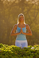 A woman performs yoga in Makena, Maui.