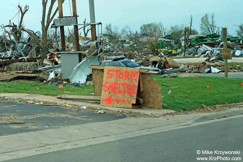 Temporary storm shelter sign among F5 tornado damage in Greensburg, KS, May, 2007