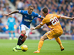 James Tavernier runs at Craig Clay