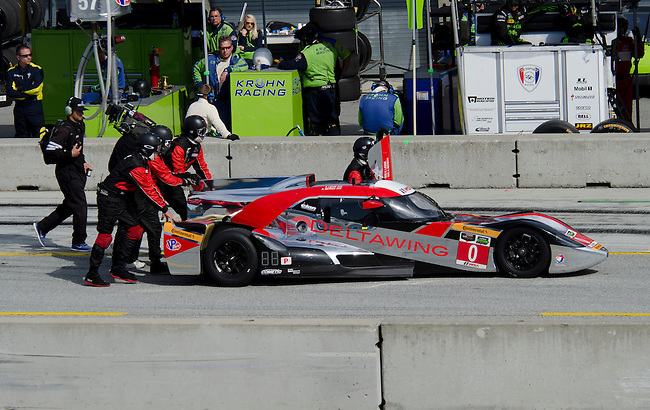 Monterey California, May 4, 2014, Laguna Seca Monterey Grand Prix, DeltaWing prototype car gets pushed down pit lane after retiring late in the race.