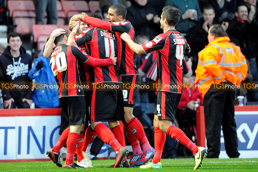 AFC Bournemouth plyers congratulate Matt Ritchie  after scoring his second goal - AFC Bournemouth vs Yeovil Town - Sky Bet Championship Football at the Goldsands Stadium, Bournemouth, Dorset - 26/12/13 - MANDATORY CREDIT: Denis Murphy/TGSPHOTO - Self billing applies where appropriate - 0845 094 6026 - contact@tgsphoto.co.uk - NO UNPAID USE