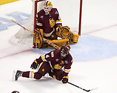Hunter Miska (UMD - 35), Neal Pionk (UMD - 4) - The University of Denver Pioneers defeated the University of Minnesota Duluth Bulldogs 3-2 to win the national championship on Saturday, April 8, 2017, at the United Center in Chicago, Illinois.