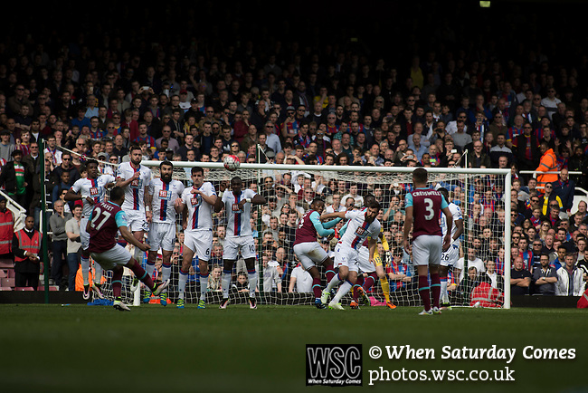West Ham United 2 Crystal Palace 2, 02/04/2016. Boleyn Ground, Premier League. Home forward Dimitri Payet curls a free -kick over the wall during the first-half action at the Boleyn Ground as West Ham United (in claret and blue) hosted Crystal Palace in a Barclays Premier League match. The Boleyn Ground at Upton Park was the club's home ground from 1904 until the end of the 2015-16 season when they moved into the Olympic Stadium, built for the 2012 London games, at nearby Stratford. The match ended in a 2-2 draw, watched by a near-capacity crowd of 34,857. Photo by Colin McPherson.