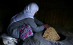 """A Palestinian woman bakes traditional bread """"Taboon"""" in the village of Salem east the West Bank City of Nablus, on December, 3, 2018. Photo by Shadi Jarar'ah"""
