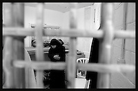 An unidentified woman is seen praying in her shared cell in the Islamic movements prisoners wing at Hasharon Israeli prison...75 female Palestinian prisoners are kept in a special wing at Hasharon prison next to Netanyah. The women's wing of the prison is divided between prisoners members of Fatah movement located in one floor and on the other floor members of Hamas and Islamic Jihad. Photo by Quique Kierszenbaum..