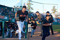 San Jose Giants left fielder Logan Baldwin (1) jogs onto the field with a Pee Wee League baseball player before a California League game against the Visalia Rawhide on April 12, 2019 at San Jose Municipal Stadium in San Jose, California. Visalia defeated San Jose 6-2. (Zachary Lucy/Four Seam Images)