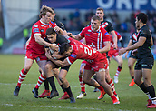 10th February 2019, AJ Bell Stadium, Salford, England; Betfred Super League rugby, Salford Red Devils versus London Broncos; Alex Walker of London Broncos is tackled by Logan Tomkins and Ken Sio of Salford Red Devils