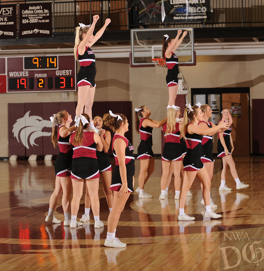 NWA Democrat-Gazette/ANDY SHUPE<br /> Lincoln cheerleaders perform during the Wolves' game with Huntsville Friday, Jan. 8, 2016, during halftime in Lincoln. Visit nwadg.com/photos to see more photographs from the game.