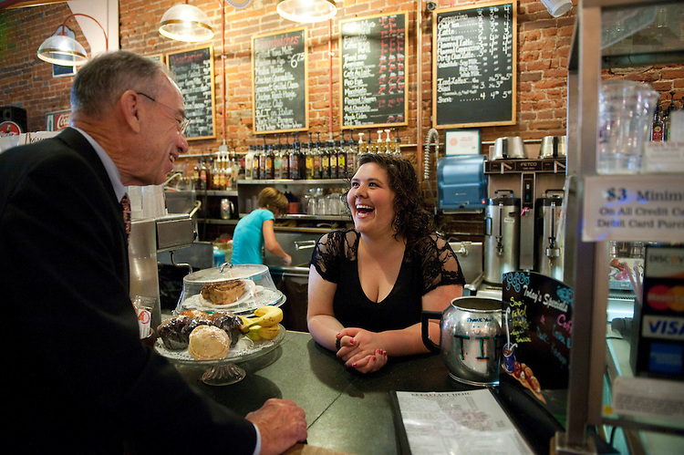 UNITED STATES - AUGUST 12:  Sen. Charles Grassley, R-Iowa, talks with Katie Ussery, an employee of Java Joe Coffeehouse, during a break in The Daily Rundown on MSNBC, hosted by Chuck Todd.  Grassley was a guest on the show which was filmed on location at Java Joe's Coffeehouse in Des Moines, Iowa.  (Photo By Tom Williams/Roll Call)