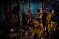 OLD DELHI, INDIA, JANUARY 12, 2016: Homeless men wake-up on the street at a sleep market where peoplr rent blankets  on January 12, 2016 in Old Delhi, India. <br /> Daniel Berehulak for The New York Times