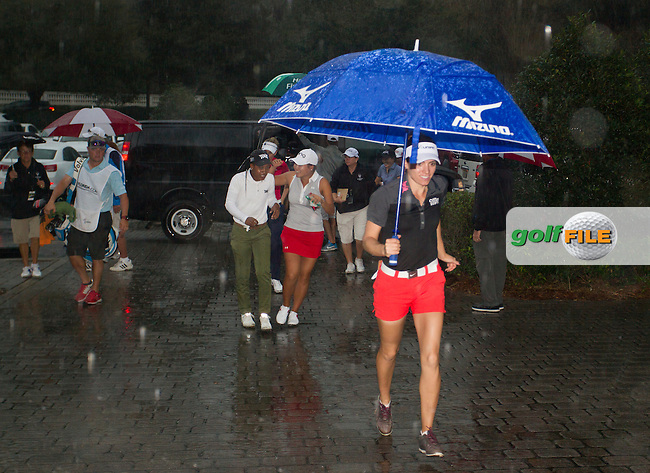 Players and Caddies run for the cover of the Clubhouse during the Second round of the LPGA Coates Golf Championship 2016 , from the Golden Ocala Golf and Equestrian Club, Ocala, Florida. 4/2/16<br /> Picture: Mark Davison | Golffile<br /> <br /> <br /> All photos usage must carry mandatory copyright credit (&copy; Golffile | Mark Davison)