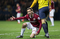 Ricky Holmes of Northampton Town complains to the linesman during the Sky Bet League 2 match between Oxford United and Northampton Town at the Kassam Stadium, Oxford, England on 16 February 2016. Photo by Andy Rowland.
