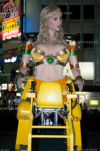 July 23 2012, Tokyo, Japan - A robot parked outside the area of Kabukicho in Shinjuku. The restaurant advertises that cost 10 billion yen (130 million) opening. Robots run by real women dressed in military, perform cabaret dance for its customers, opened in the Kabukicho area, Shinjuku in Tokyo. (Photo by Rodrigo Reyes Marin/AFLO)