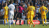 Referee Peter Bankes directs Preston North End's Alex John-Baptiste off the field after showing him a red card<br /> <br /> Photographer Alex Dodd/CameraSport<br /> <br /> The EFL Sky Bet Championship - Leeds United v Preston North End - Saturday 8th April 2017 - Elland Road - Leeds<br /> <br /> World Copyright &copy; 2017 CameraSport. All rights reserved. 43 Linden Ave. Countesthorpe. Leicester. England. LE8 5PG - Tel: +44 (0) 116 277 4147 - admin@camerasport.com - www.camerasport.com
