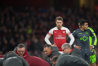 Arsenal's Aaron Ramsey looking at  Danny Welbeck leg injury during the UEFA Europa League match between Arsenal and Sporting Clube de Portugal at the Emirates Stadium, London, England on 8 November 2018. Photo by Andrew Aleksiejczuk / PRiME Media Images.