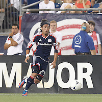 New England Revolution midfielder Lee Nguyen (24) on the attack. In a Major League Soccer (MLS) match, Montreal Impact defeated the New England Revolution, 1-0, at Gillette Stadium on August 12, 2012.