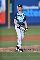 Asheville Tourists starting pitcher Shelby Lackey (10) during a game against the Greenville Drive on Hippie Night at McCormick Field on July 11, 2019 in Asheville, North Carolina. The Drive defeated the Tourists 6-2. (Tony Farlow/Four Seam Images)