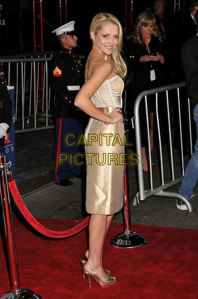 "TERESA PALMER .""Bedtime Stories"" Los Angeles Premiere at the El Capitan Theatre, Hollywood, California, USA..December 18th, 2008.full length gold cream satin silk dress hand on hip slingback heels shoes corset top skirt strapless .CAP/ADM/BP.©Byron Purvis/AdMedia/Capital Pictures."
