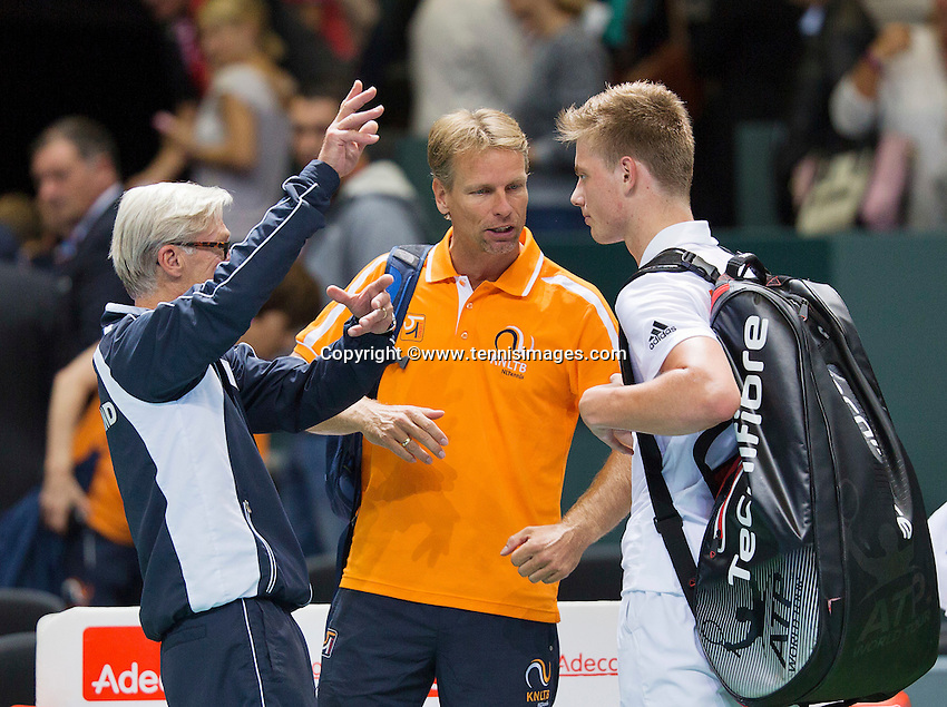 Switserland, Genève, September 20, 2015, Tennis,   Davis Cup, Switserland-Netherlands, Tim van Rijthoven (NED) listens to the advice of captain Jan Siemerink and coach Martin Bohm after the match against Laaksonen<br /> Photo: Tennisimages/Henk Koster