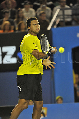 27 January 2010, 2010 Australian Open Tennis, day 10, Melbourne, Australia. Jo-Willfried TSONGA (FRA) vs Novak DJOKOVIV (SRB). Jo-Willfried TSONGA in action winning the quarter final. Photo by Peter Blakeman/Actionplus.  Editorial Licenses only.