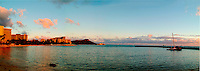 Diamond Head and Waikiki Beach at sunset, shot from the Hilton Hawaiian Village lagoon.