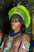 "Altamira, Brazil. ""Xingu Vivo Para Sempre"" protest meeting about the proposed Belo Monte hydroeletric dam and other dams on the Xingu river and its tributaries. Kayapo with ""Brasil"" on his beadwork armband and National flag on his necklace."