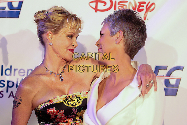 Melanie Griffith, Jamie Lee Curtis.Children's Hospital Los Angeles Gala: Noche de Ninos, Los Angeles, California, USA, 20th October 2012..portrait headshot strapless black necklace print arm around jacket white .CAP/ADM/PH.©Paul A. Hebert/AdMedia/Capital Pictures.