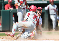 NWA Democrat-Gazette/CHARLIE KAIJO Arkansas outfielder Heston Kjerstad (18) slides home but is called out during the second game of the NCAA super regional baseball, Sunday, June 10, 2018 at Baum Stadium in Fayetteville. Arkansas fell to South Carolina 5-8.