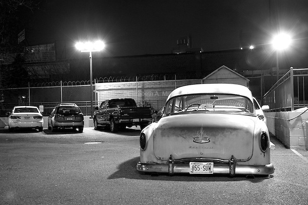 An old car parked in the parking lot outside of Hotel Le Jolie in the Williamsburg neighborhood of Brooklyn, New York, on 17 December 2011.