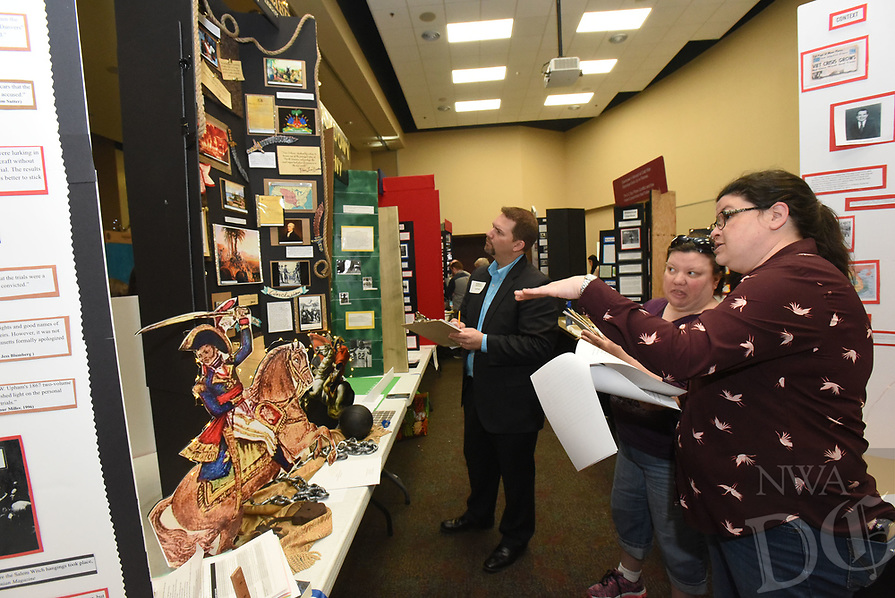 NWA Democrat-Gazette/FLIP PUTTHOFF<br /> HISTORY ON DISPLAY<br /> Jim Dotson (from left), Sandy Novotny and Jama Grove (cq) judge Saturday March 3 2018 history displays created by middle school and high school students at the regional National History Day contest held at Northwest Arkansas Community College. Some 450 students from Northwest Arkansas schools took part in the contest, hoping to advance to the state competition. Categories included performances, documentaries, exhibits, paper and websites.