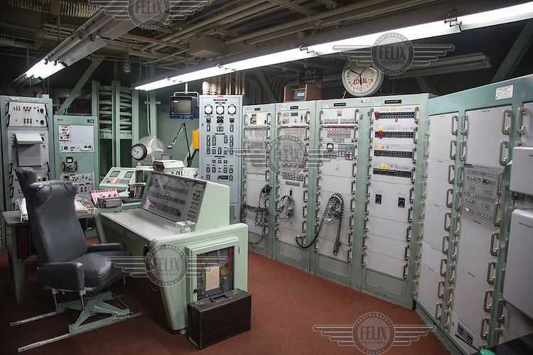 Launch control center.  <br /> <br /> The Titan Missile Museum is the only remaining Titan II site open to the public. The Titan II was capable of launching from its underground silo in 58 seconds and could deliver a nine megaton thermonuclear warhead to its target more than 6300 miles (10,000 km) away in less than thirty minutes. For more than two decades, 54 Titan II missile complexes across the United States stood &quot;on alert&quot; 24 hours a day, seven days a week.
