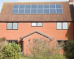 Photovoltaic solar panels on roof of modern suburban house, Martlesham, Suffolk, England