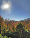 A blazing sun on a crystal clear day illuminates a colorful scene in the mountains around Gatlinburg, Tennessee. Three exposure HDR.