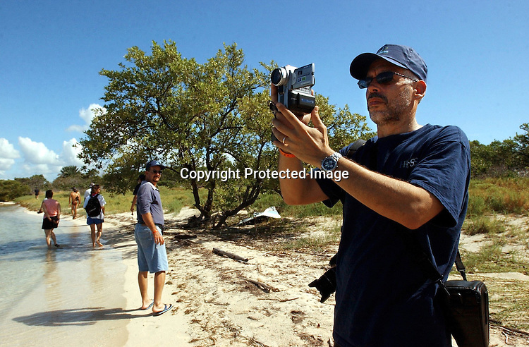 .FUTURE VIEWS.David Guggenheim, past president of the Conservancy of Southwest Florida and currently a vice president of the Ocean Conservancy in Washington, D.C., collects video and still photographs during his visit to Cayo Blanco. Guggenheim was exploring how his organizationÕs work along CubaÕs Gulf of Mexico coast might tie into the work of Cuban scientists elsewhere in the country. Erik Kellar/Naples Daily News..Cuba Trip.Scanned 11/21/2003.Erik Kellar/Staff