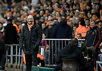 Blackpool 2 Liverpool 1, 12/01/2011. Bloomfield Road, Premier League. Blackpool FC manager Ian Holloway and his opposite number Kenny Dalglish smiling from the side of the pitch at Bloomfield Road stadium during the match against Liverpool FC in the Premier League. The home side won by two goals to one in front of a crowd of 16,089. It was the first time the clubs had met in a league match since Blackpool were last in the top division of English football in 1970-71. Photo by Colin McPherson.