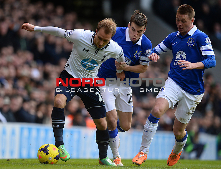 Everton's Seamus Coleman holds onto Tottenham Hotspur's Christian Eriksen as he attempts to play the ball   09/02/2014 - SPORT - FOOTBALL - London - White Hart Lane - Tottenham Hotspur v Everton - Barclays Premier League<br /> Foto nph / Meredith<br /> <br /> ***** OUT OF UK *****