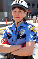 Bicycle officer age 43 at Liberty State bank bicycle safety rodeo.  St Paul  Minnesota USA